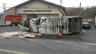 A garbage truck struck a utility pole and rolled over in front of the Leithsville fire station in Lower Saucon Township Tuesday morning, closing a busy section of Rt. 412.