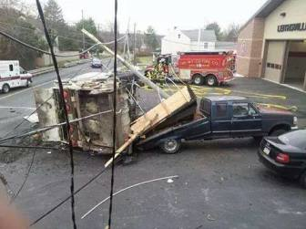 A Facebook photo shows a garbage truck on its side in front of the Leithsville fire station on Rt. 412 in Lower Saucon Township on Dec. 2, 2014.
