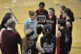 SV Girls Junior High Coach Ochse talks strategy with her team.