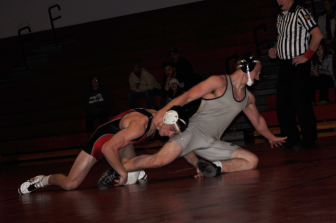Saucon's Jason Lynch on his way to a 16-0 tech fall.