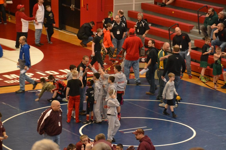 Saucon youth wrestlers gather around Coach Csencsits for a pre-tourney pep talk.