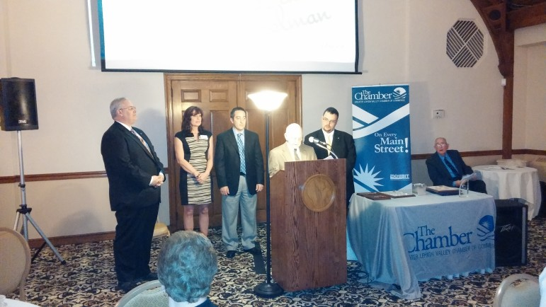 Community Commitment Award recipient David Heintzelman receives a recognition from Hellertown borough officials, including Mayor Richard Fluck (at podium), borough manager Cathy Hartranft, councilman Joe Pampanin and council president Tom Rieger.