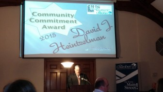 David Heintzelman accepts the Hellertown-Lower Saucon Chamber of Commerce's 2015 Community Commitment Award at a banquet at Silver Creek Country Club.