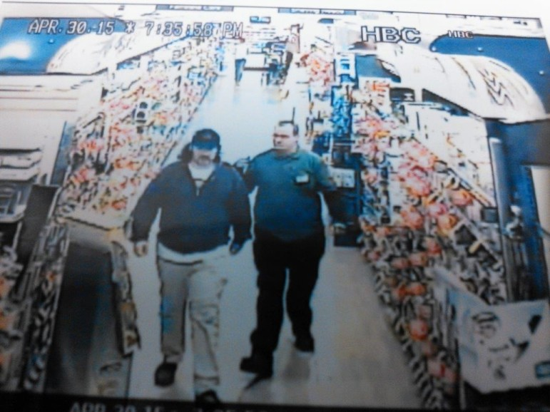 An unidentified man is escorted out of the Giant supermarket after allegedly taking photos of women in the store. Lower Saucon Township Police hope to identify him.