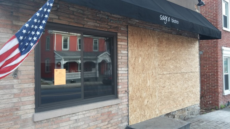 "A sign posted in the front window of Sagra Bistro by Hellertown zoning and codes enforcement officer Kris Russo announces that ""this premises is unsafe for use or human habitation; the use and occupancy of this premises for human habitation is prohibited and unlawful."""