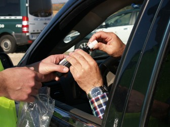 A driver is administered a breath test at a DUI checkpoint (FILE PHOTO).