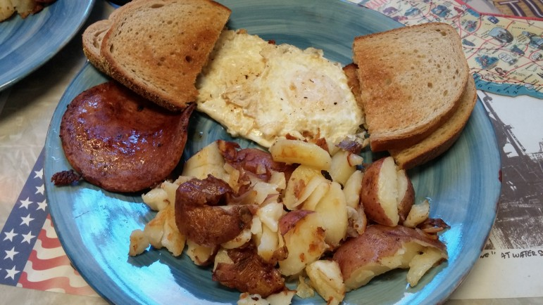 Breakfast at Bergy's: Toast, eggs over easy, home fries and pork roll.