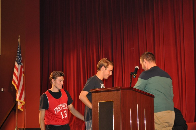 Soccer Coach Mel Moyer recognizes his Outstanding Seniors Sean and patrick Cyphers