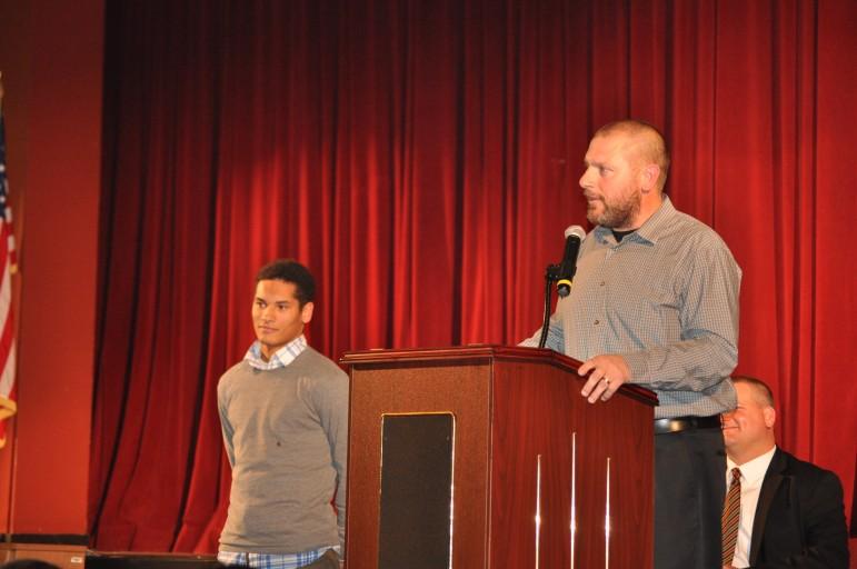 Football Coach Matt Evancho introducing team MVP Evan Culver