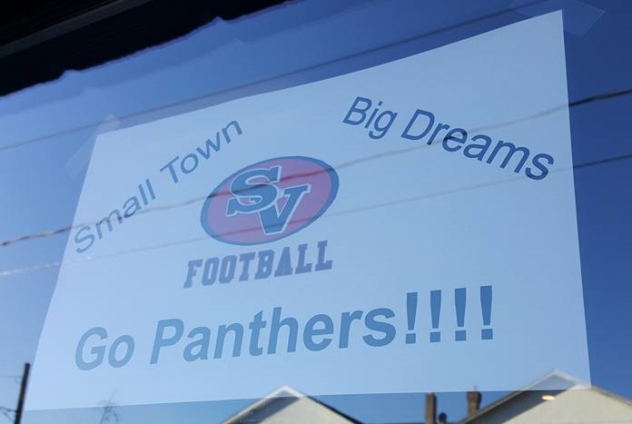 A sign expressing support for the Saucon Valley Panthers and their quest for a District XI football championship is hung in the window of Maui Kitchens, 1308 Main St., Hellertown. The Saucon Valley Football Booster Club has printed the signs and is distributing them to local businesses this week.