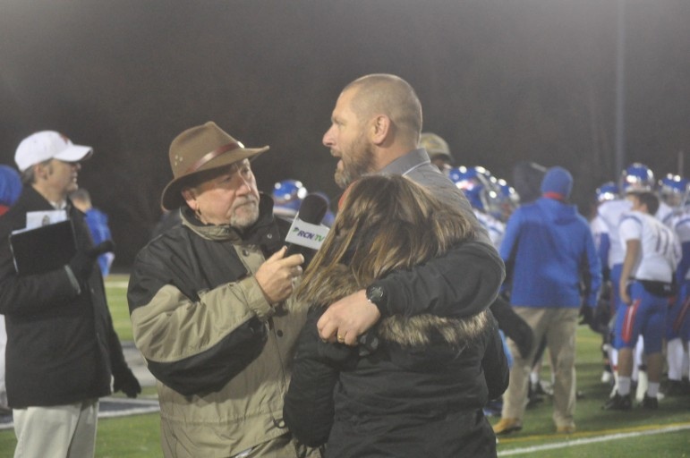 Coach Evancho gets a hug from daughter Kayla while giving an interview following the PIAA Quarterfinal win over Selinsgrove