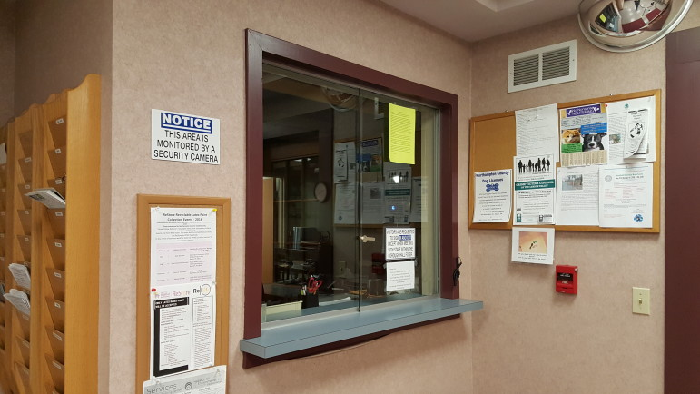 The current transaction window near the entrance to Hellertown Borough Hall features standard sliding glass windows.