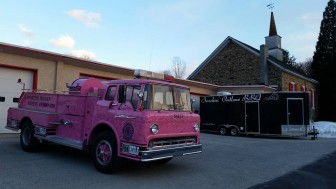 The Pink Heals Lehigh Valley chapter's pink fire truck is parked outside Southeastern Volunteer Fire Co. in Lower Saucon Township for Smokin' Outlaw BBQ's 4th annual 'Movin' & Groovin' to the 60s and 70s' fundraiser event.