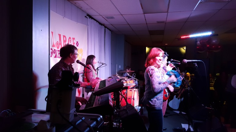 The Large Flowerheads performed three sets at the fundraiser.