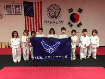 Several of Saucon Valley Karate Academy's classes recently posed for photos with the U.S. Air Force banner for Geiter's daughter, who is currently studying at the Air Force Academy.