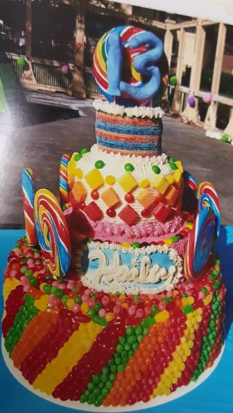 Custom cakes and cake pops are one of Hellertown Bakery owner Leiane McCarty's specialties. Pictured is a custom candy-covered cake she baked for a 13th birthday party. The bakery will have a photo-book of McCarty's cake creations on hand for customers to peruse.