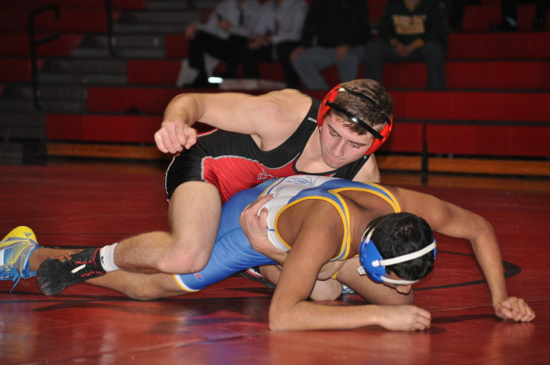 Nate Harka of Saucon Valley rides his way to a pin.