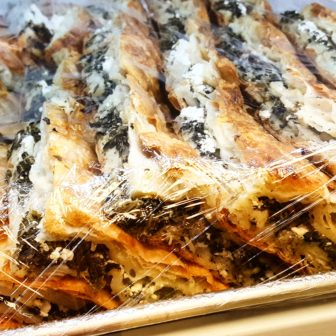 Spinach pie is prepared with feta cheese and flaky phyllo dough.