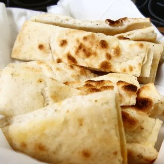 Warm, flavorful pita bread for dipping is served in baskets.