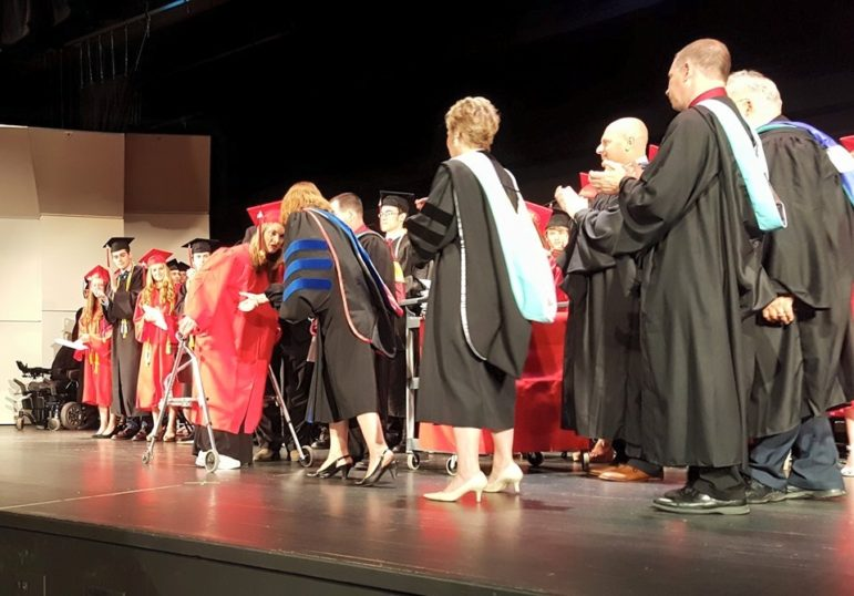 Senior Carli Ziegler walks across the high school stage to receive her diploma, as a member of Saucon Valley's Class of 2016.