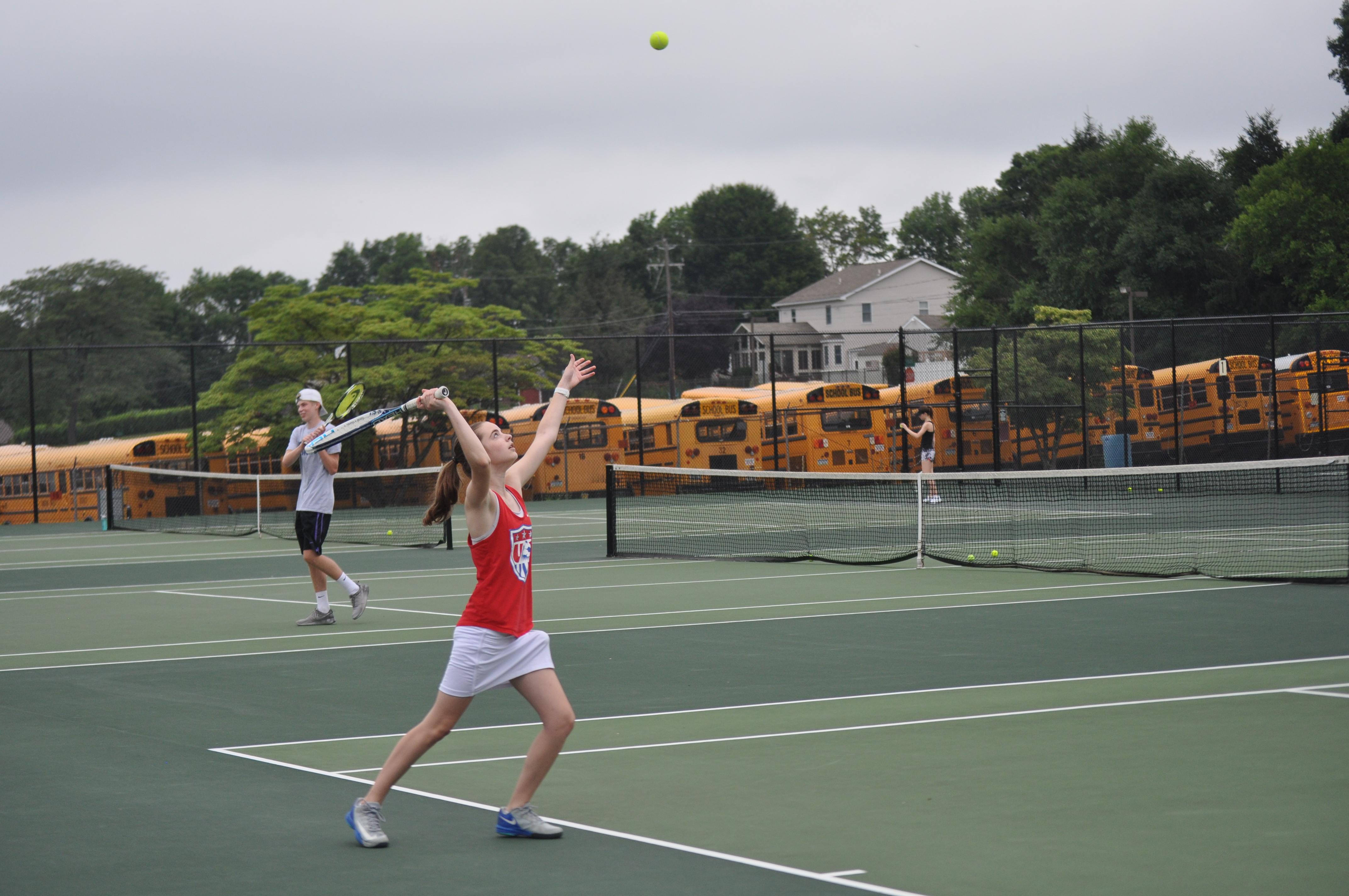 Rising sophomore Emily Ackerman works oner serve at Coach Ochse's open court.
