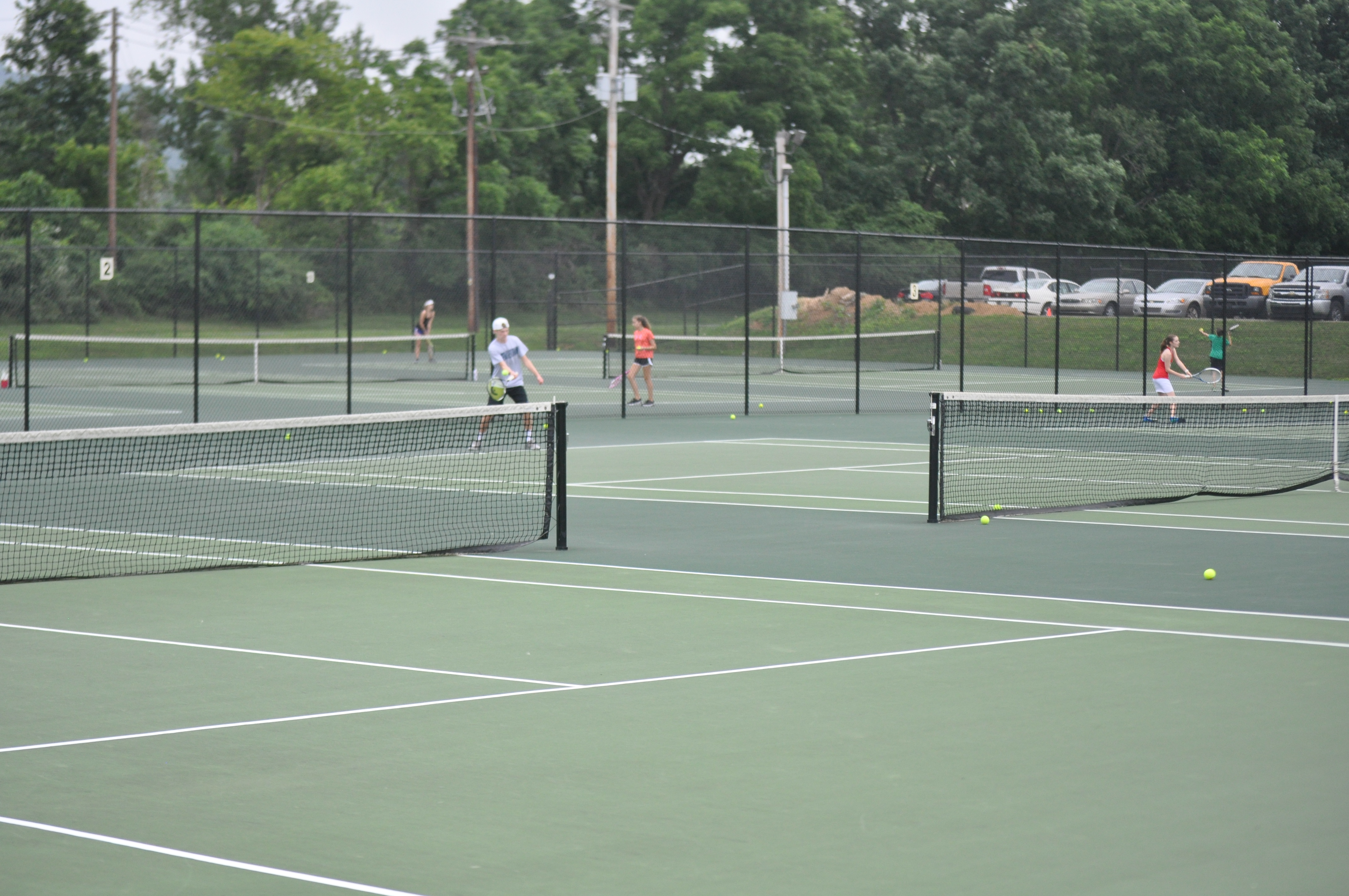 Garrett Deppert and other boys take part in Coach Ochse's open court sessions.