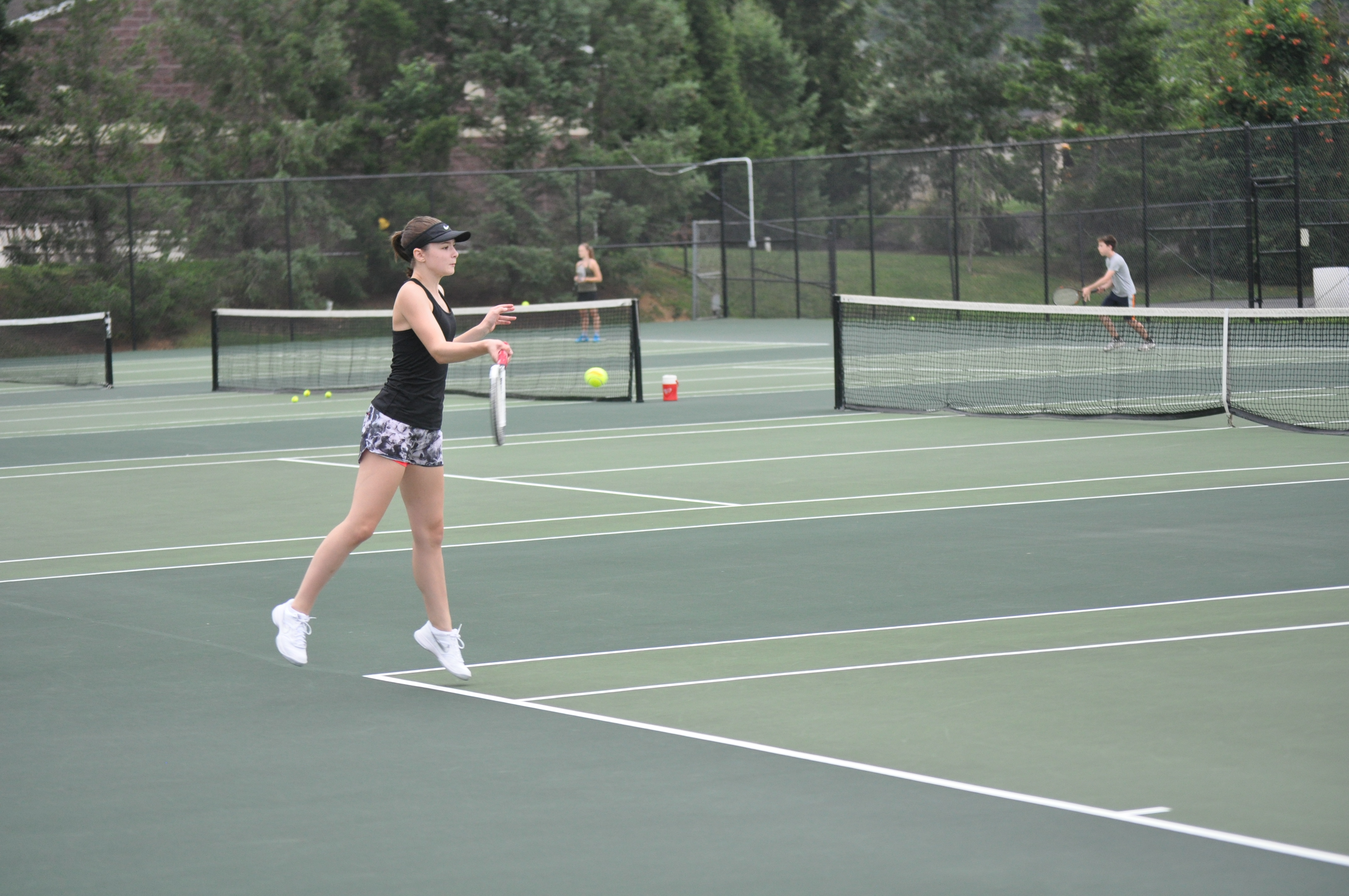 Junior Meghan Altemose working on her forehand.