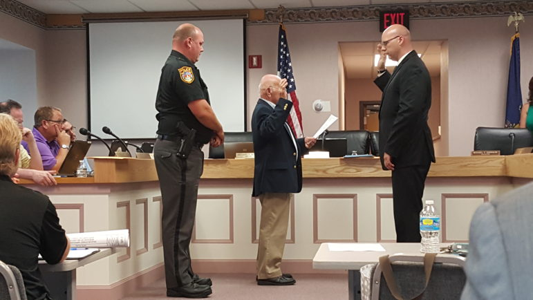Jacob Fouts is administered an oath by Hellertown Mayor Richard Fluck upon his appointment as a part-time officer with the Hellertown Police Department. At left is Police Chief Robert Fluck.