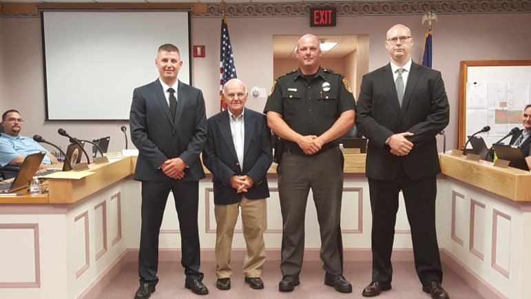 From left, Ofc. Christopher Pfancook, Hellertown Mayor Richard Fluck, Police Chief Robert Fluck and Ofc. Jacob Fouts