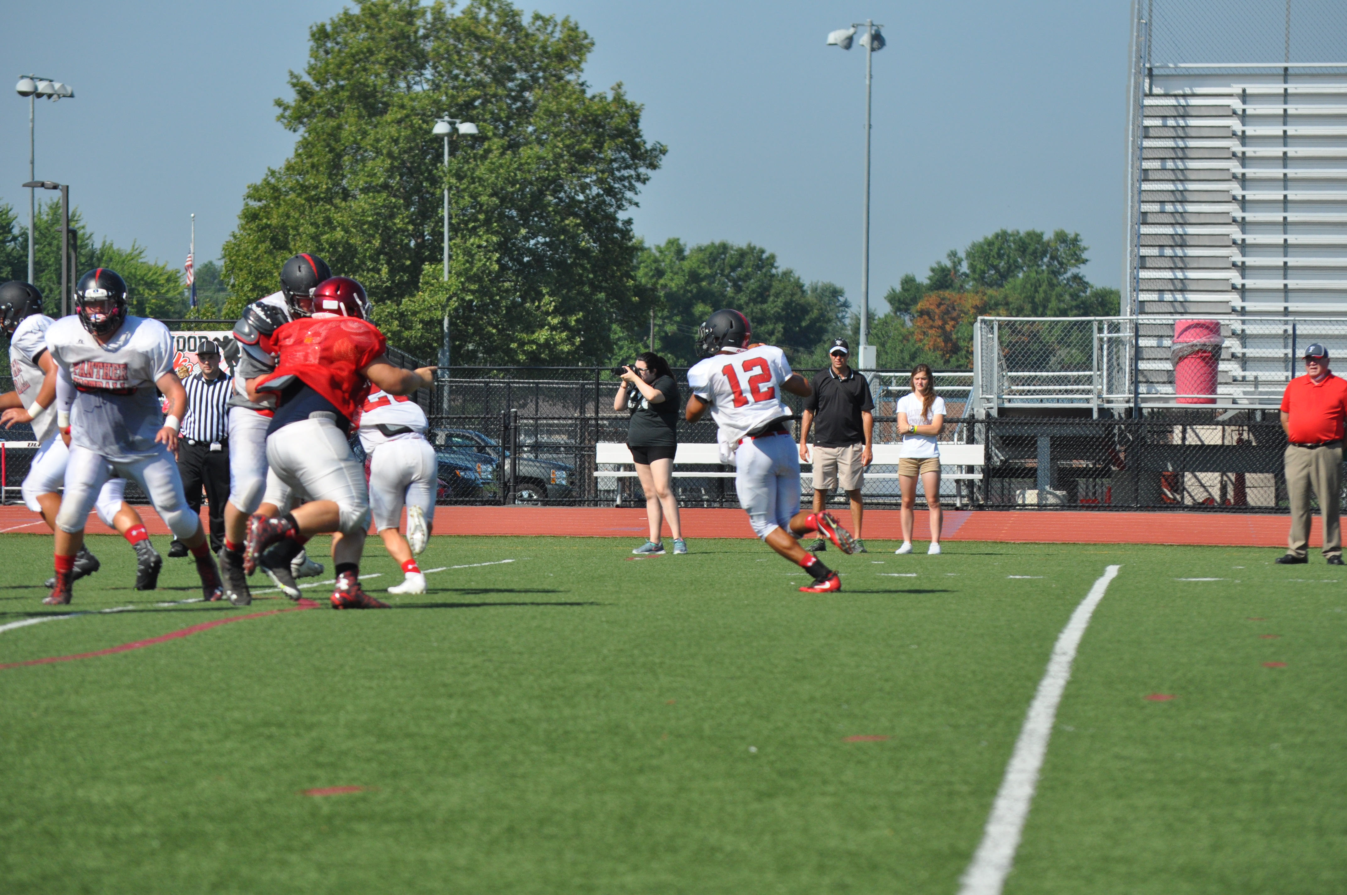 Saucon Valley Quarterback Brandon Holub rolls right looking for an open receiver during the Panther's scrimmage with Fleetwood on Saturday.