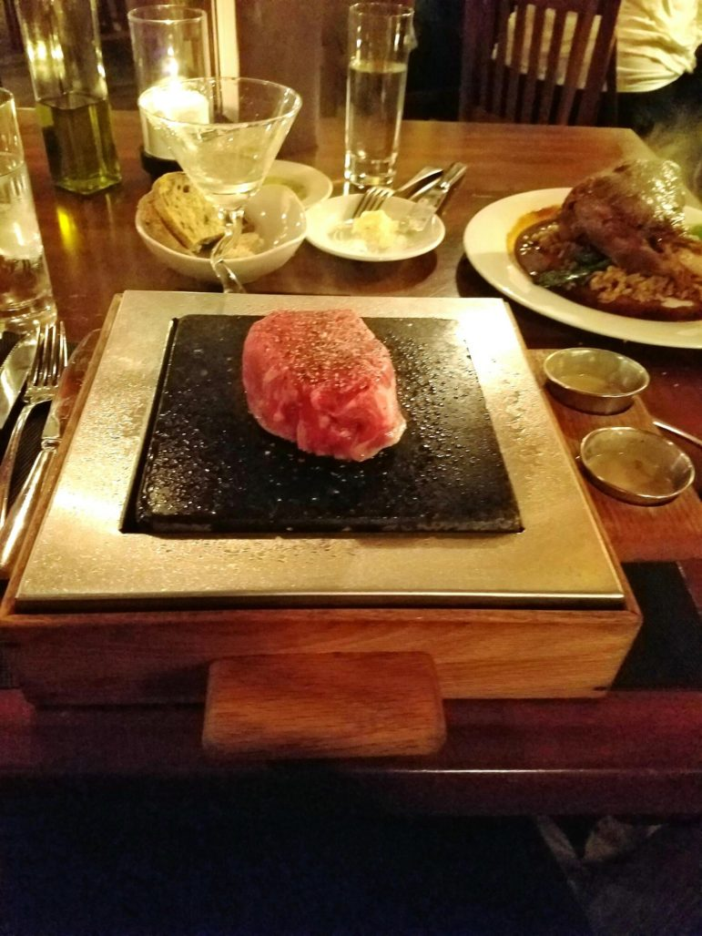 Steak on a Stone ($33.50) is a filet mignon served on a hot stone, which allows each diner to cook it to their desired level of doneness.