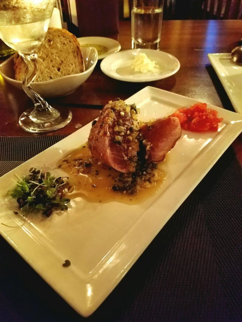 Seared Prosciutto-Wrapped Tuna with limoncello, shallots, capers, garlic butter, roasted tomatoes and micro greens ($13.50)