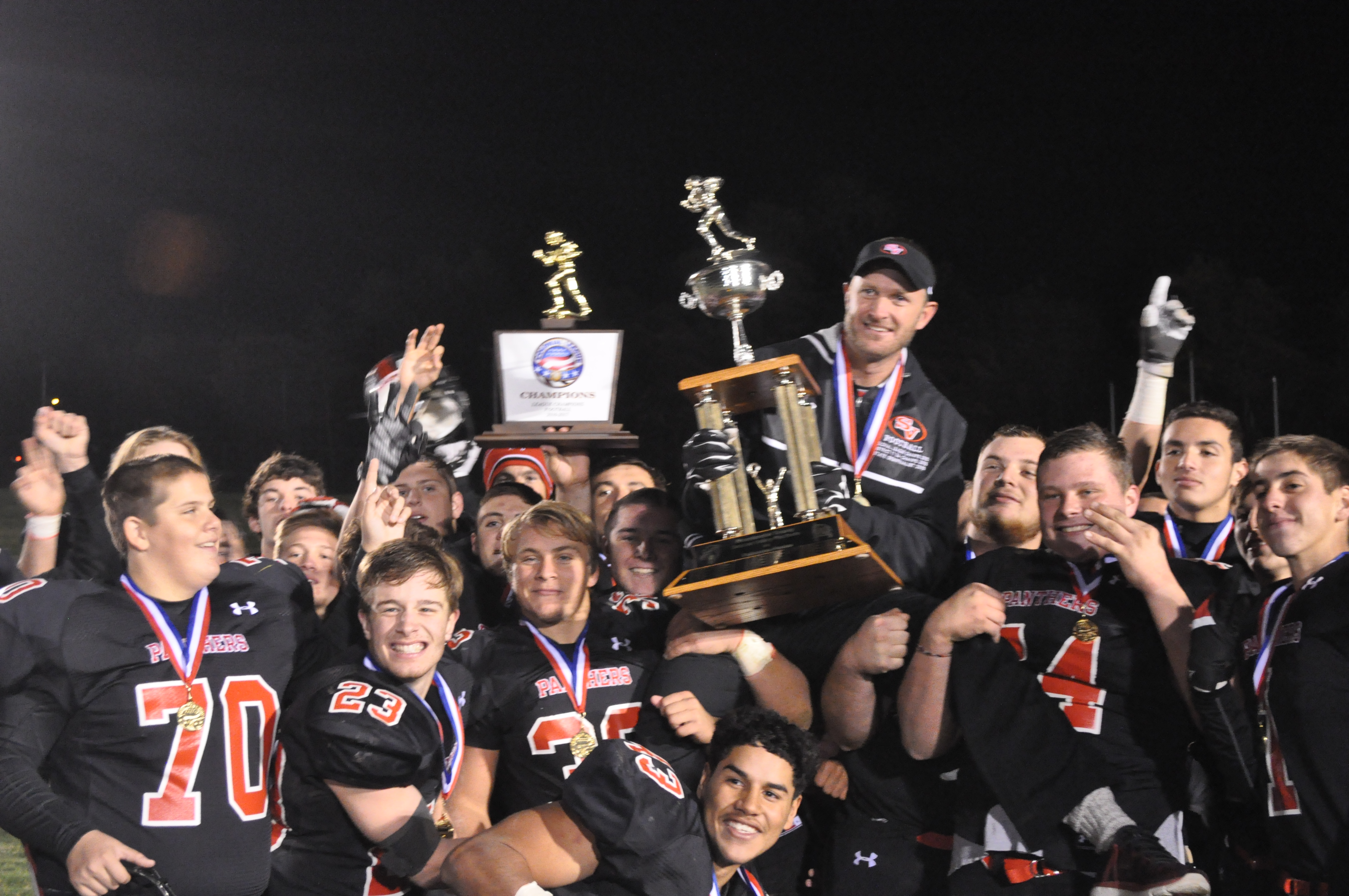 The Panthers give Coach Sams a championship ride.