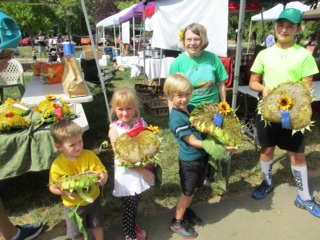 Beverly Rosewicz with the children's category winners of the Sunflower Seed Head Contest at the Saucon Valley Farmers' Market