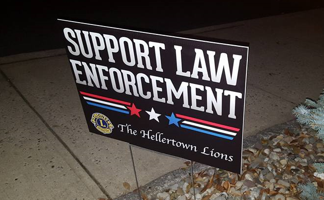 The Hellertown Lions are selling these signs to benefit local police.
