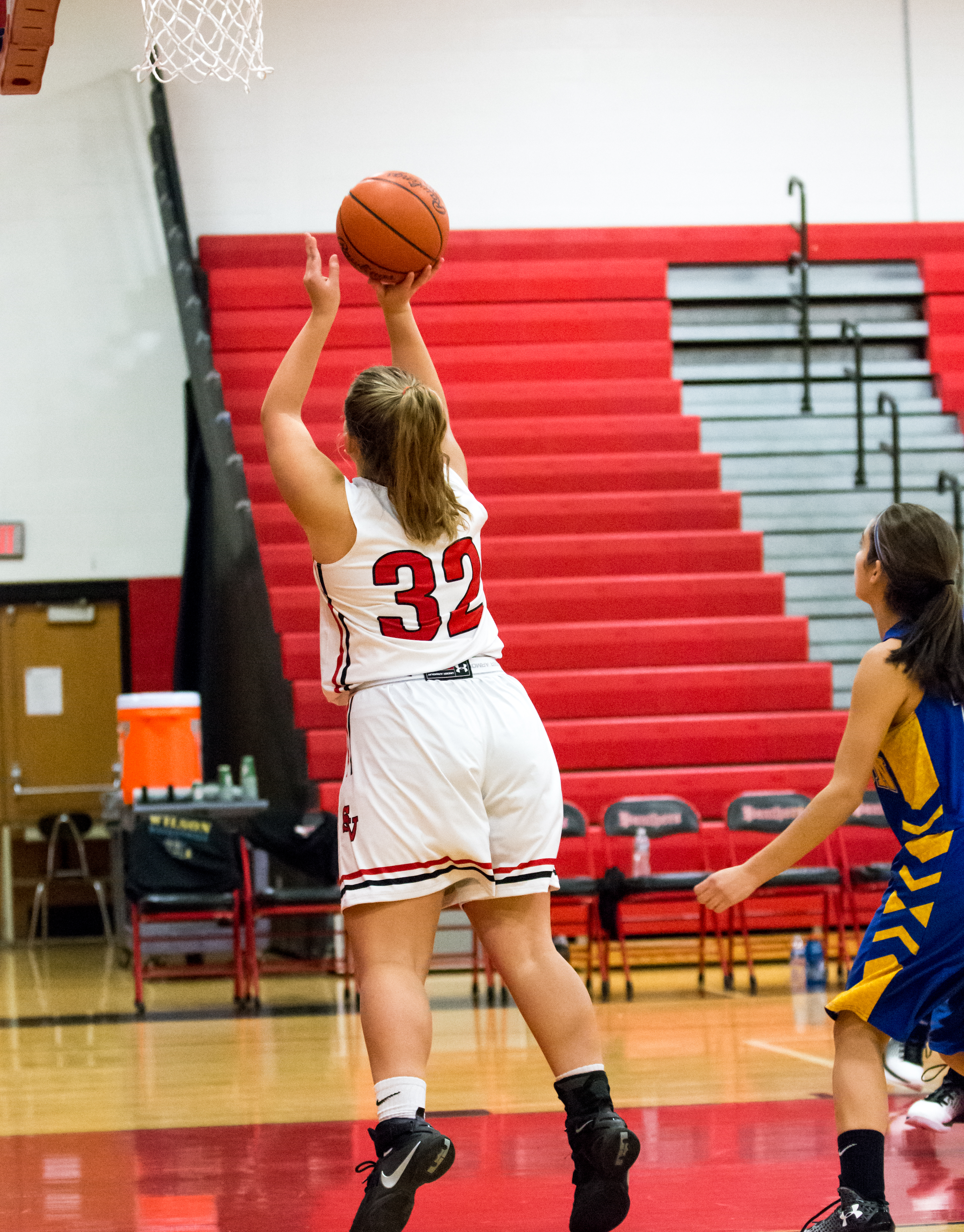 Olivia Williams scores two of her team high fifteen points in the opening quarter against the Wilson Warriors.