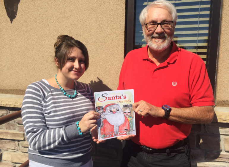 "Hellertown author Larry Deibert and freelance artist/illustrator Ashley Reigle of Center Valley partnered to create ""Santa's Day Jobs,"" a children's story and coloring book that was recently published."