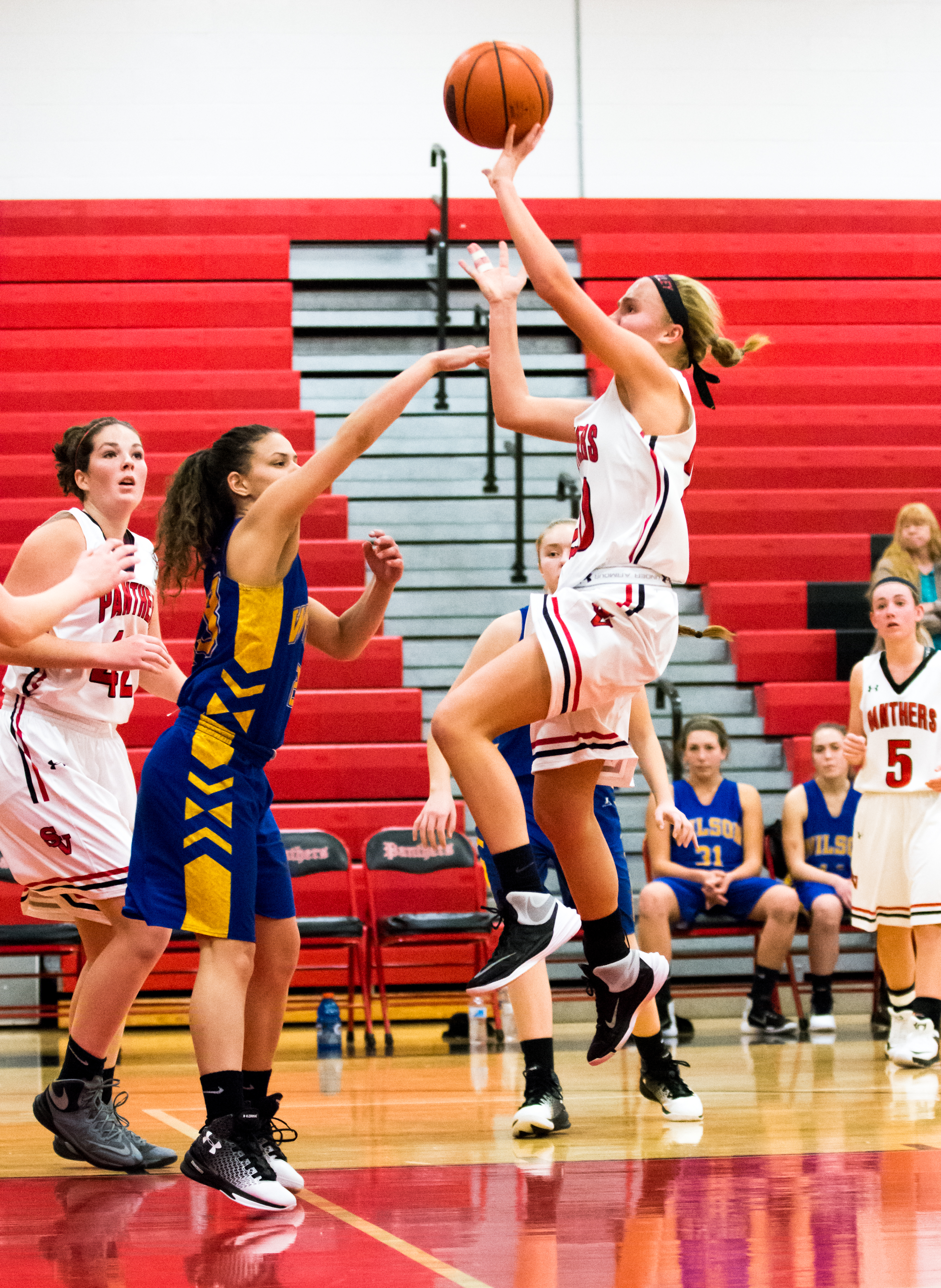 Sophomore, Brooke Riefenstahl drives hard to the hoop for the Panther lead.